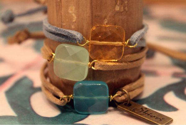 bracelets with colored crystals and suede crowns